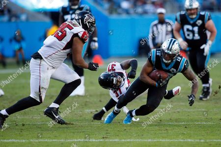 Atlanta Falcons free safety Ricardo Allen (37) and defensive tackle Jack Crawford (95) chase Carolina Panthers wide receiver D.J. Moore (12)nduring the second half of an NFL football game in Charlotte, N.C