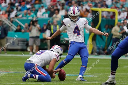 Buffalo Bills kicker Stephen Hauschka (4) kicks a field goal, during the first half at an NFL football game against the Miami Dolphins, in Miami Gardens, Fla. Buffalo Bills punter Corey Bojorquez (9) holds