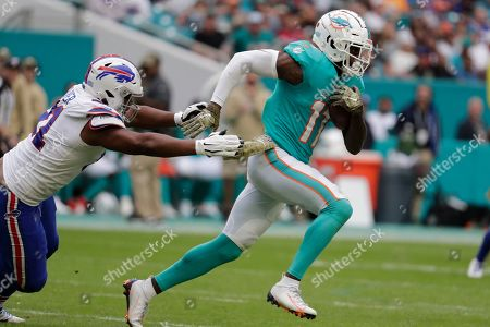 Ed Oliver, DeVante Parker. Buffalo Bills defensive tackle Ed Oliver (91) attempts to take Miami Dolphins wide receiver DeVante Parker (11), during the second half at an NFL football game, in Miami Gardens, Fla