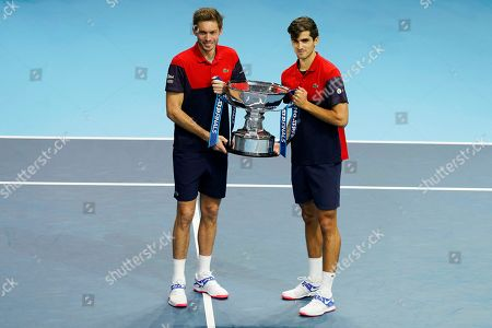 France's Pierre-Hugues Herbert (R) and Nicolas Mahut (L) pose with their trophy after winning the men's doubles final against New Zealand's Michael Venus and South Africa's Raven Klaasen at the ATP World Tour Finals tennis tournament in London, Britain, 17 November 2019.