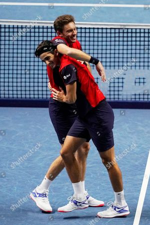 France's Pierre-Hugues Herbert (L) and Nicolas Mahut (R) celebrate after winning the men's doubles final against New Zealand's Michael Venus and South Africa's Raven Klaasen at the ATP World Tour Finals tennis tournament in London, Britain, 17 November 2019.