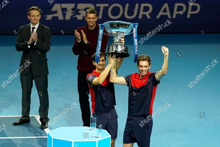 Stock Image of France's Pierre-Hugues Herbert (C) and Nicolas Mahut (R) pose with their trophy after winning the men's doubles final against New Zealand's Michael Venus and South Africa's Raven Klaasen at the ATP World Tour Finals tennis tournament in London, Britain, 17 November 2019.