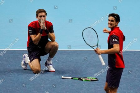 Stock Picture of France's Pierre-Hugues Herbert (R) and Nicolas Mahut (L) celebrate after winning the men's doubles final against New Zealand's Michael Venus and South Africa's Raven Klaasen at the ATP World Tour Finals tennis tournament in London, Britain, 17 November 2019.