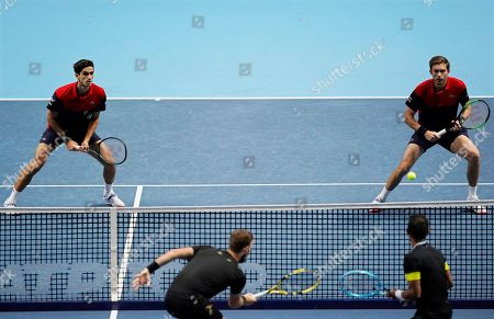 France's Pierre-Hugues Herbert (L) and Nicolas Mahut (R) in action against New Zealand's Michael Venus and South Africa's Raven Klaasen during their men's doubles final at the ATP World Tour Finals tennis tournament in London, Britain, 17 November 2019.