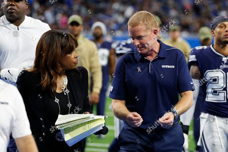 Fox NFL side line reporter Pam Oliver talks with Dallas Cowboys head coach Jason Garrett before the second half of an NFL football game against the Detroit Lions, in Detroit