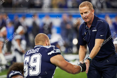 Dallas Cowboys head coach Jason Garrett shakes hands with offensive tackle Brandon Knight (69) during warm ups prior to an NFL football game against the Detroit Lions, in Detroit