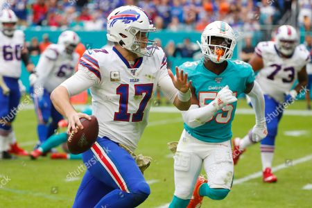 Josh Allen, Jerome Baker. Buffalo Bills quarterback Josh Allen (17) runs for a touchdown ahead of Miami Dolphins outside linebacker Jerome Baker (55), during the second half at an NFL football game, in Miami Gardens, Fla