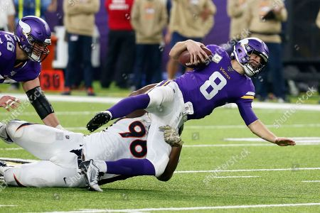 Minnesota Vikings quarterback Kirk Cousins (8) is sacked by Denver Broncos defensive tackle Shelby Harris (96) during the second half of an NFL football game, in Minneapolis