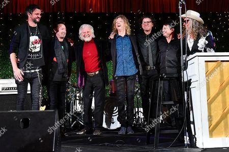 Julian Lennon, second from left, and Chuck Leavell, third from left, join with members of Collective Soul to take a bow after performing together during Captain Planet Foundation's Annual Benefit Gala at Flourish Atlanta, in Atlanta