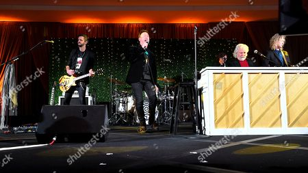 Julian Lennon, center, sings as Chuck Leavell plays keyboard, while performing with Collective Soul during Captain Planet Foundation's Annual Benefit Gala at Flourish Atlanta, in Atlanta