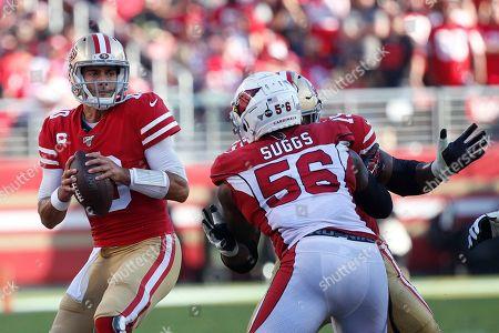 San Francisco 49ers quarterback Jimmy Garoppolo passes againast Arizona Cardinals outside linebacker Terrell Suggs (56) during the first half of an NFL football game in Santa Clara, Calif