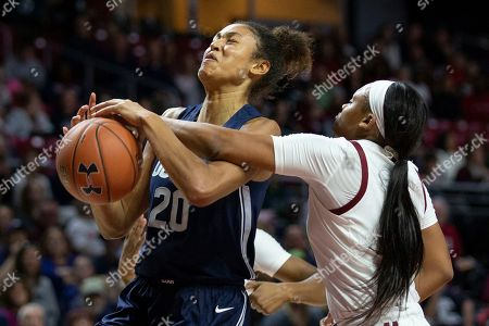 Temple guard Ashley Jones, right, blocks a shot by Connecticut forward Olivia Nelson-Ododa (20) during the first half of an NCAA college basketball game, in Philadelphia