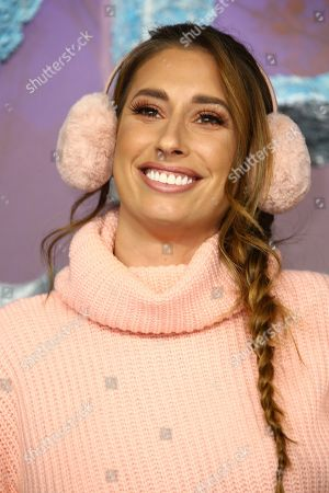 Stacey Soloman poses for photographers upon arrival at the European premiere of 'Frozen 2', in central London