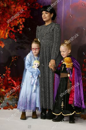 Lily Allen, Marnie Rose Cooper, Ethel Cooper. Singer Lily Allen, centre poses for photographers alongside her daughters Marnie Rose Cooper, right and Ethel Cooper upon arrival at the European premiere of 'Frozen 2', in central London