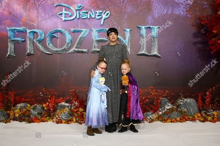 Stock Photo of Lily Allen, Marnie Rose Cooper, Ethel Cooper. Singer Lily Allen, centre poses for photographers alongside her daughters Marnie Rose Cooper, right and Ethel Cooper upon arrival at the European premiere of 'Frozen 2', in central London