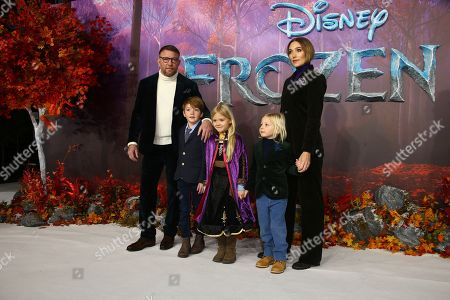 Guy Ritchie, Jacqui Ainsley. Guy Ritchie, left and Jacqui Ainsley, right pose for photographers upon arrival at the European premiere of 'Frozen 2', in central London