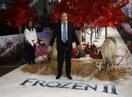 Peter Del Vecho poses for photographers upon arrival at the European premiere of 'Frozen 2', in central London