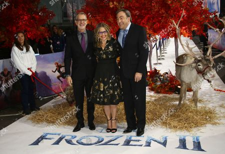 Jennifer Lee, Peter Del Vecho, Chris Buck. From left, directors Chris Buck and Jennifer Lee pose for photographers with producer Peter Del Vecho upon arrival at the European premiere of 'Frozen 2', in central London