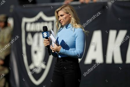 CBS sideline reporter Melanie Collins during the first half of an NFL football game between the Oakland Raiders and the Cincinnati Bengals in Oakland, Calif