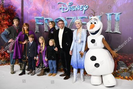 Guy Ritchie (C), his wife Jacqui Ainsley (C-L) and children pose for photographers with characters from the animated movie at the European premiere of 'Frozen 2' in London, Britain, 17 November 2019. The movie sequel opens in British theaters on 22 November.