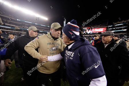 New England Patriots head coach Bill Belichick, right, and Philadelphia Eagles head coach Doug Pederson meet after an NFL football game, in Philadelphia. New England won 17-10