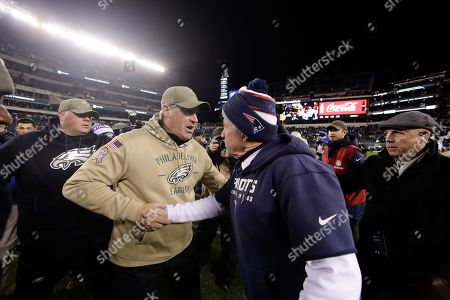 Stock Image of New England Patriots head coach Bill Belichick, right, and Philadelphia Eagles head coach Doug Pederson meet after an NFL football game, in Philadelphia. New England won 17-10