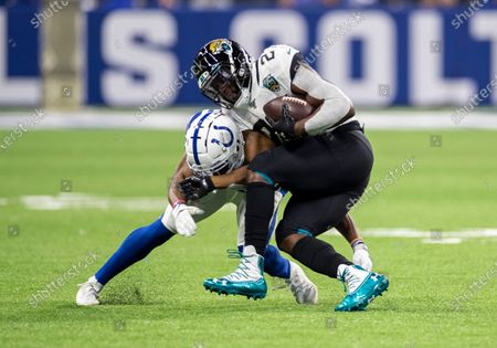 Indianapolis Colts cornerback Kenny Moore (23) makes the tackle on Jacksonville running back Leonard Fournette (27) during NFL football game action between the Jacksonville Jaguars and the Indianapolis Colts at Lucas Oil Stadium in Indianapolis, Indiana. Indianapolis defeated Jacksonville 33-13