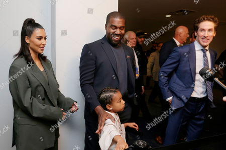 From left, Kim Kardashian West, North West, Kanye West and Sr. Pastor Joel Osteen answers media question after the 11 am service at Lakewood Church, in Houston