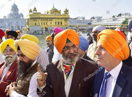 Former Australian Prime Minister Tony Abbott pays obeisance at the Golden Temple, along with members of the Shiromani Gurdwara Parbandhak Committee