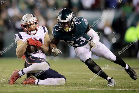 Rodney McLeod, Julian Edelman. New England Patriots' Julian Edelman (11) catches a pass against Philadelphia Eagles' Rodney McLeod (23) during the second half of an NFL football game, in Philadelphia