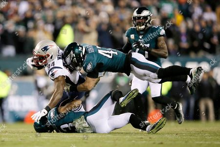 New England Patriots' Benjamin Watson (84) is tackled by Philadelphia Eagles' Nate Gerry (47) and Rodney McLeod (23) during the first half of an NFL football game, in Philadelphia
