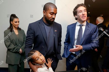 From left, Kim Kardashian West, North West, Kanye West and Joel Osteen answers questions after the 11 am service at Lakewood Church, in Houston