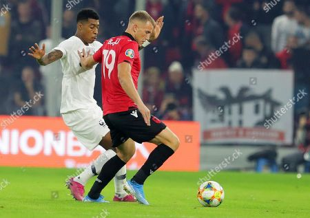 Stock Photo of Albania's Bekim Balaj (R) in action against France's Presnel Kimpembe (L) during the UEFA EURO 2020 qualifying soccer match between Albania and France in Tirana, Albania, 17 November 2019.