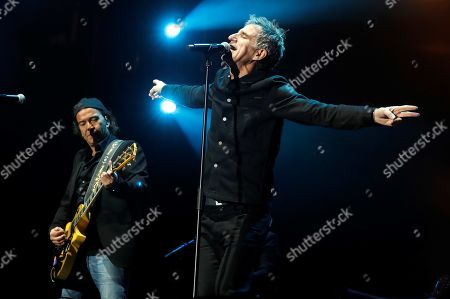 Stock Photo of Alvaro Urquijo (L) of Spanish band Los Secretos and Spanish singer Mikel Erentxun (R) perform on stage during the band's concert at the Wizink Center in Madrid, Spain, 17 November 2019. Los Secretos commemorated the death of frontman and leader Enrique Urquijo 20 years ago.
