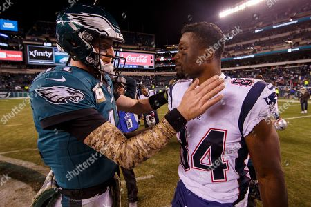 Philadelphia Eagles quarterback Carson Wentz (11) talks with New England Patriots tight end Benjamin Watson (84) following the NFL game between the New England Patriots and the Philadelphia Eagles at Lincoln Financial Field in Philadelphia, Pennsylvania