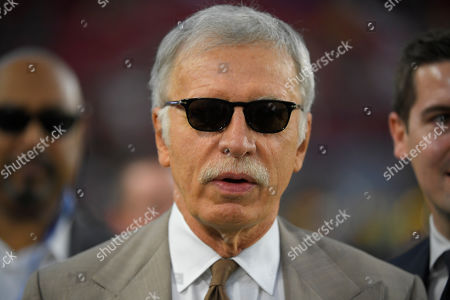 Los Angeles Rams owner Stan Kroenke watches during warm ups before an NFL football game against the Chicago Bears, in Los Angeles