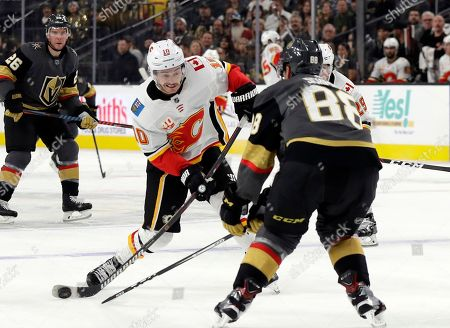 Calgary Flames center Derek Ryan (10) shoots against the Vegas Golden Knights during the first period of an NHL hockey game, in Las Vegas