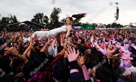 Sophie Hawley-Weld, of German-American musical duo Sofi Tukker, crowd surfs with fans during the Corona Capital music festival in Mexico City