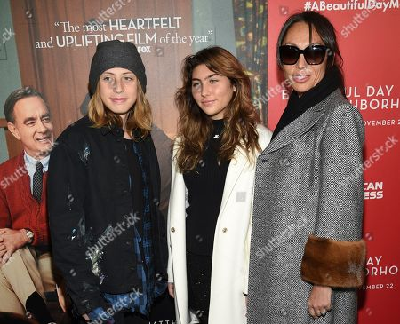 """Christopher Nicholas Cornell, Toni Cornell, Vicky Karayiannis. Chris Cornell's family, from left, son Christopher Nicholas Cornell, daughter Toni Cornell and wife Vicky Karayiannis attend a special screening of """"A Beautiful Day In The Neighborhood"""" at the Henry R. Luce Auditorium, in New York"""