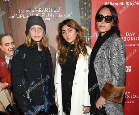 """Stock Image of Christopher Nicholas Cornell, Toni Cornell, Vicky Karayiannis. Chris Cornell's family, from left, son Christopher Nicholas Cornell, daughter Toni Cornell and wife Vicky Karayiannis attend a special screening of """"A Beautiful Day In The Neighborhood"""" at the Henry R. Luce Auditorium, in New York"""
