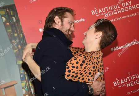 """Alexander Skarsgard, Marielle Heller. Actor Alexander Skarsgard, left, and director Marielle Heller pose together at a special screening of """"A Beautiful Day In The Neighborhood"""" at the Henry R. Luce Auditorium, in New York"""
