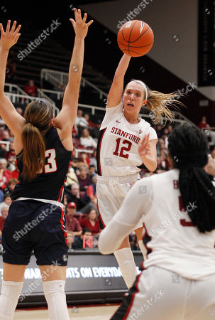 Lexie Hull, Francesca Belibi, Melody Kempton. Stanford's Lexie Hull (12) passes to Francesca Belibi, front right, as Gonzaga's Melody Kempton, left, defends during the second half of an NCAA college basketball game, in Stanford, Calif. Stanford beat Gonzaga 76-70 in overtime