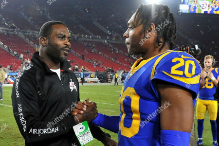 Los Angeles, CA.Former NFL player Michael Vick shakes hands with Los Angeles Rams cornerback Jalen Ramsey #20 after the NFL football game against the Chicago Bears at the Los Angeles Memorial Coliseum in Los Angeles, California..The Los Angeles Rams defeat the Chicago Bears 17-7.Mandatory Photo Credit: Louis Lopez/CSM