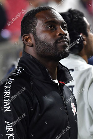 Los Angeles, CA.Former NFL player Michael Vick on the field after the NFL football game against the Chicago Bears at the Los Angeles Memorial Coliseum in Los Angeles, California..The Los Angeles Rams defeat the Chicago Bears 17-7.Mandatory Photo Credit: Louis Lopez/CSM