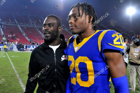 Los Angeles, CA.Former NFL player Michael Vick with Los Angeles Rams cornerback Jalen Ramsey #20 after the NFL football game against the Chicago Bears at the Los Angeles Memorial Coliseum in Los Angeles, California..The Los Angeles Rams defeat the Chicago Bears 17-7.Mandatory Photo Credit: Louis Lopez/CSM