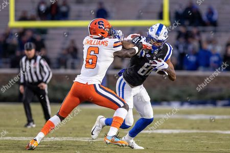 Duke's Aaron Young (81) carries the ball as Syracuse's Trill Williams (6) attempts a tackle during an NCAA college football game in Durham, N.C