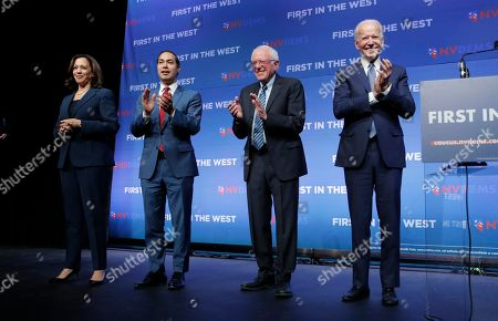 From left, Democratic presidential candidates Sen. Kamala Harris, D-Calif., former Housing and Urban Development Secretary candidate Julian Castro, Sen. Bernie Sanders, I-Vt., and Former Vice President Joe Biden stand on stage during a fundraiser for the Nevada Democratic Party, in Las Vegas