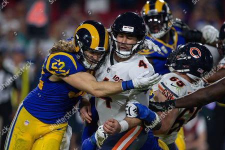 Los Angeles, CA...Los Angeles Rams outside linebacker Clay Matthews (52) puts a hit on backup Chicago Bears quarterback Chase Daniel (4)nduring the NFL game between Chicago Bears vs Los Angeles Rams at the Los Angeles Memorial Coliseum in Los Angeles, Ca on November, 2019. Jevone Moore