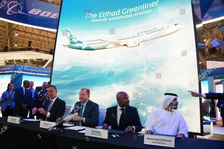Stock Image of Tony Douglas, Stanley A. Deal, Ted Colbert, Mohammad al-Bulooki. Etihad CEO Tony Douglas, left, Boeing Commercial Airplanes president and CEO Stanley A. Deal, second left, Boeing Global Services President and CEO Ted Colbert, third left and Etihad COO Mohammad al-Bulooki, right, attend a news conference at the Dubai Airshow in Dubai, United Arab Emirates, . Abu Dhabi's flagship carrier Etihad said Monday it had partnered with Boeing Co. to launch what they say will be one of the world's most fuel-efficient long haul airplanes as the company seeks to save costs on fuel and position itself as a more environmentally-conscious choice for travelers