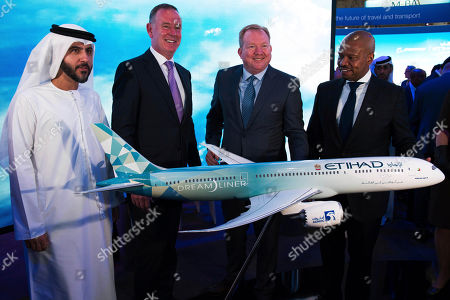 Stock Photo of Stanley A. Deal, Ted Colbert. Etihad COO Mohammad al-Bulooki, left, Etihad CEO Tony Douglas, second left, Boeing Commercial Airplanes president and CEO Stanley A. Deal, third left, and Boeing Global Services President and CEO Ted Colbert, right, pose in front of a Boeing 787 Dreamliner model at the Dubai Airshow in Dubai, United Arab Emirates, . Abu Dhabi's flagship carrier Etihad said Monday it had partnered with Boeing Co. to launch what they say will be one of the world's most fuel-efficient long haul airplanes as the company seeks to save costs on fuel and position itself as a more environmentally-conscious choice for travelers